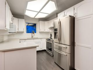 Photo 15: 55 SILVERSTONE Road NW in Calgary: Silver Springs Detached for sale : MLS®# A1058654