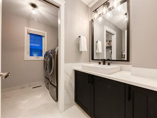 Photo 23: 55 SILVERSTONE Road NW in Calgary: Silver Springs Detached for sale : MLS®# A1058654