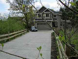 Photo 2: 1308 COAST MERIDIAN RD in Coquitlam: Burke Mountain House for sale : MLS®# V1048044