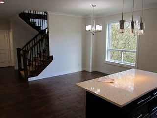 Photo 7: 1308 COAST MERIDIAN RD in Coquitlam: Burke Mountain House for sale : MLS®# V1048044