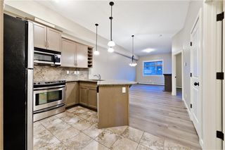 Photo 27: #423 35 ASPENMONT HT SW in Calgary: Aspen Woods Condo for sale : MLS®# C4207910