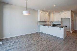 Photo 4: 980 SETON Circle SE in Calgary: Seton Semi Detached for sale : MLS®# C4276346