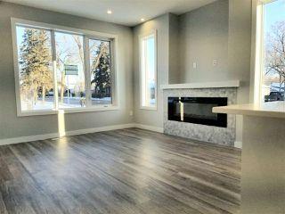 Photo 4: 10107 113 Avenue in Edmonton: Zone 08 Townhouse for sale : MLS®# E4182243