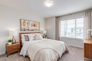 Photo 5: 124 WOLF HOLLOW Park SE in Calgary: C-281 Row/Townhouse for sale : MLS®# A1028407