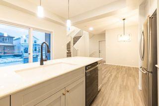 Photo 11: 4417 KINSELLA Green in Edmonton: Zone 56 House for sale : MLS®# E4218682