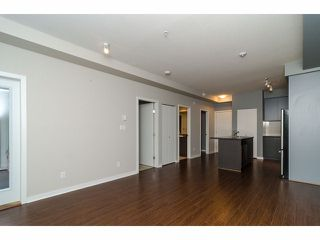 """Photo 8: 101 6420 194TH Street in Surrey: Clayton Condo for sale in """"Waterstone"""" (Cloverdale)  : MLS®# F1321755"""
