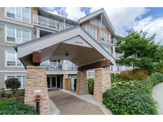 """Photo 1: 101 6420 194TH Street in Surrey: Clayton Condo for sale in """"Waterstone"""" (Cloverdale)  : MLS®# F1321755"""