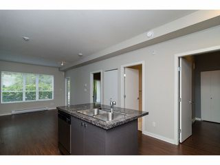 """Photo 11: 101 6420 194TH Street in Surrey: Clayton Condo for sale in """"Waterstone"""" (Cloverdale)  : MLS®# F1321755"""