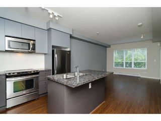 """Photo 5: 101 6420 194TH Street in Surrey: Clayton Condo for sale in """"Waterstone"""" (Cloverdale)  : MLS®# F1321755"""