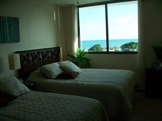 Photo 15: Playa Blanca Resort mid floor ocean view 199K