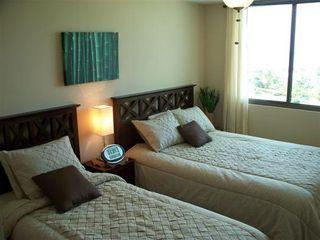 Photo 11: Playa Blanca Resort mid floor ocean view 199K