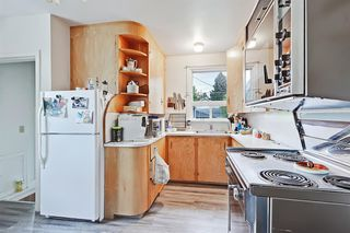 Photo 5: 504 22 Avenue NE in Calgary: Winston Heights/Mountview Detached for sale : MLS®# A1013457