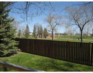 Photo 2: Spacious 3 Bedroom home backing onto a park!