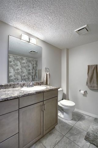 Photo 18: 305 40 Glenbrook Crescent: Cochrane Apartment for sale : MLS®# A1052145