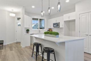 Photo 1: 8129 222 Street in Edmonton: Zone 58 House Half Duplex for sale : MLS®# E4223417