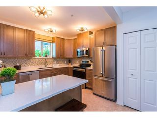 """Photo 8: 102 2733 ATLIN Place in Coquitlam: Coquitlam East Condo for sale in """"ATLIN COURT"""" : MLS®# R2475795"""