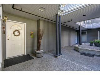 "Photo 2: 102 2733 ATLIN Place in Coquitlam: Coquitlam East Condo for sale in ""ATLIN COURT"" : MLS®# R2475795"