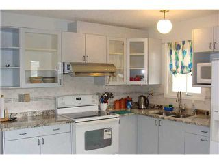 Photo 5: 60 ABBERCOVE Way SE in CALGARY: Abbeydale Residential Detached Single Family for sale (Calgary)  : MLS®# C3532149