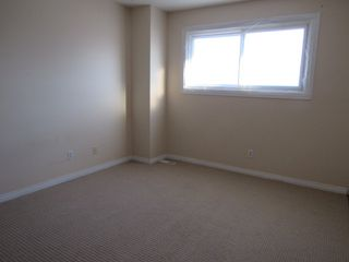 Photo 8: 9301 Morinville Drive in Morinville: Townhouse for rent