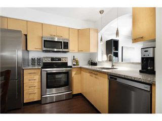 Photo 2: # 306 8495 JELLICOE ST in Vancouver: Fraserview VE Condo for sale (Vancouver East)  : MLS®# V1026912