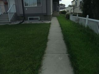 Photo 3: 11531 82 Street in Edmonton: Zone 05 Duplex Front and Back for sale : MLS®# E4168518