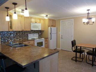 Photo 2: 2D 3031 200 Street in Cedar Creek Estates: Home for sale : MLS®# F1127913