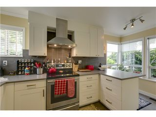 Photo 1: 8481 Portside Court in Vancouver: Fraserview Townhouse for sale (Vancouver East)  : MLS®# V1072483