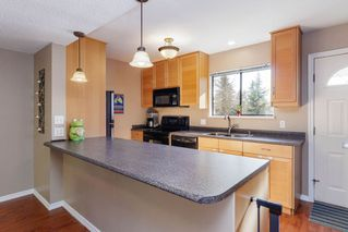 "Photo 6: 905 BRITTON Drive in Port Moody: North Shore Pt Moody Townhouse for sale in ""WOODSIDE VILLAGE"" : MLS®# R2457346"