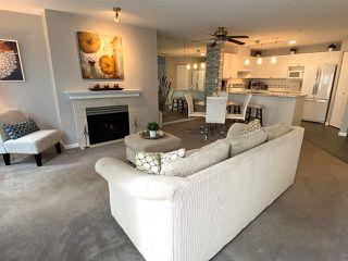 """Photo 7: #414 15268 105 Avenue in Surrey: Guildford Condo for sale in """"Georgian Gardens"""" (North Surrey)  : MLS®# R2467700"""