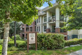 "Photo 1: 102 245 ROSS Drive in New Westminster: Fraserview NW Condo for sale in ""The GROVE at VICTORIA HILL"" : MLS®# R2490300"