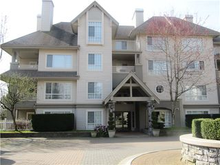 Photo 1: # 103 1242 TOWN CENTRE BV in Coquitlam: Canyon Springs Condo for sale : MLS®# V1010413