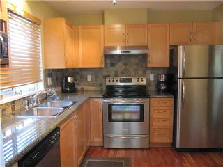 Photo 2: # 103 1242 TOWN CENTRE BV in Coquitlam: Canyon Springs Condo for sale : MLS®# V1010413