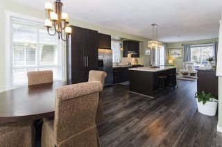 """Photo 4: 102 2418 AVON Place in Port Coquitlam: Riverwood Townhouse for sale in """"LINKS"""" : MLS®# R2403660"""