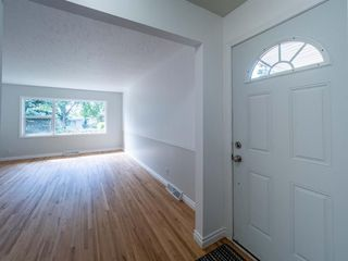 Photo 3: 1020W 39 Avenue NW in Calgary: Cambrian Heights Semi Detached for sale : MLS®# A1025366