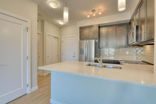 Photo 13: 109 300 AUBURN MEADOWS Manor SE in Calgary: Auburn Bay Apartment for sale : MLS®# A1026766