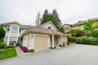 "Photo 1: 206 16031 82 Avenue in Surrey: Fleetwood Tynehead Townhouse for sale in ""SPRINGFIELD"" : MLS®# R2411898"