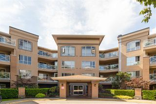 "Photo 1: 111 2559 PARKVIEW Lane in Port Coquitlam: Central Pt Coquitlam Condo for sale in ""THE CRESCENT"" : MLS®# R2486202"