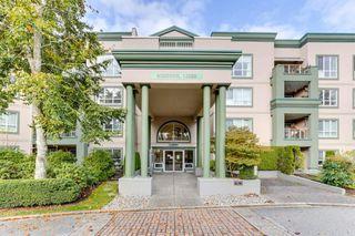 "Photo 3: 328 13880 70TH Avenue in Surrey: East Newton Condo for sale in ""Chelsea Gardens"" : MLS®# R2512963"