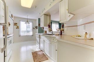 "Photo 11: 328 13880 70TH Avenue in Surrey: East Newton Condo for sale in ""Chelsea Gardens"" : MLS®# R2512963"
