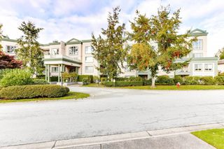 "Photo 2: 328 13880 70TH Avenue in Surrey: East Newton Condo for sale in ""Chelsea Gardens"" : MLS®# R2512963"