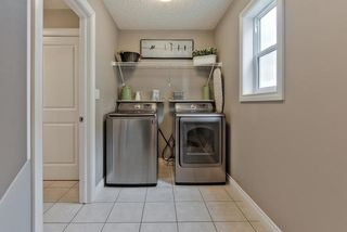Photo 11: 910 ALBANY PT NW in Edmonton: Zone 27 House for sale : MLS®# E4170540