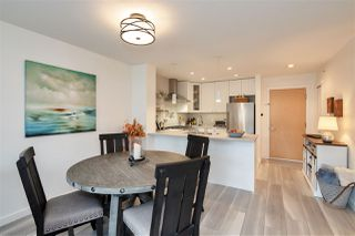 "Photo 3: 405 400 KLAHANIE Drive in Port Moody: Port Moody Centre Condo for sale in ""THE TIDES"" : MLS®# R2512517"
