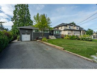 Main Photo: 1310 SUMMIT Drive in Coquitlam: Harbour Chines House for sale : MLS®# R2489772