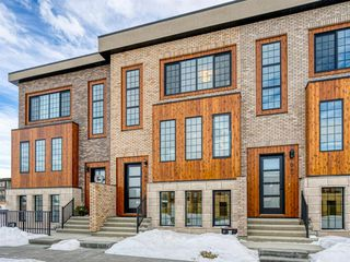 Main Photo: 309 81 Greenbriar Place NW in Calgary: Greenwood/Greenbriar Row/Townhouse for sale : MLS®# A1058995