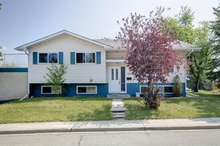Main Photo: 604 Canterbury Drive SW in Calgary: Canyon Meadows Detached for sale : MLS®# A1061790