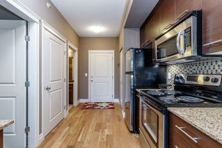"""Photo 5: 418 2343 ATKINS Avenue in Port Coquitlam: Central Pt Coquitlam Condo for sale in """"The Pearl"""" : MLS®# R2405860"""