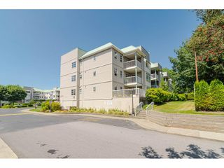Photo 3: 303 9767 140 Street in Surrey: Whalley Condo for sale (North Surrey)  : MLS®# R2392119