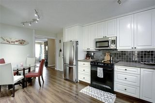 Photo 5: 36 MCKENNA RD SE in Calgary: McKenzie Lake Detached for sale : MLS®# C4300100