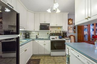 Photo 5: 6N 203 LYNNVIEW Road SE in Calgary: Ogden Row/Townhouse for sale : MLS®# A1017459