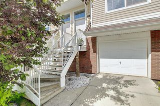 Main Photo: 113 TUSCANY SPRINGS Gardens NW in Calgary: Tuscany Row/Townhouse for sale : MLS®# A1011029